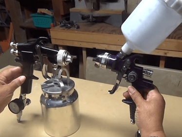 What are the classifications of spray guns?